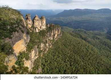 Three sisters rock formation with last sunlight in the Blue Mountains, Katoomba, New South Wales, Australia