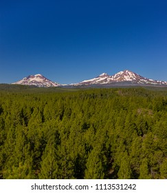 THREE SISTERS WILDERNESS, OREGON, USA - JULY 15, 2009: Three Sisters mountains in Deschutes National Forest. L-R, South Sister, Middle Sister, and North Sister volcanoes in Cascade range.