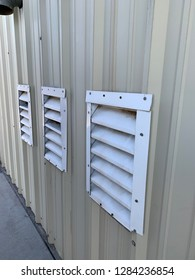 Three slatted vents in side of laundromat building outside