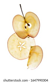 three slices of apple in the background light on a white background
