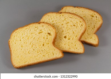 Three slices of brioche on gray background