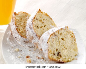 Three slices cake with nuts and powder sugar