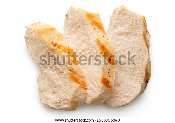 Three slices of grilled chicken breast with grill marks isolated on white. Top view.