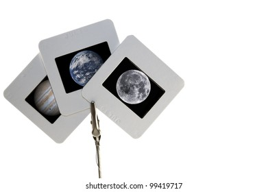 Three slide photographs containing images of Earth, Jupiter and the Moon. Elements of this image furnished by NASA