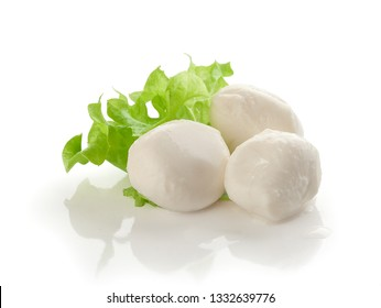 Three small balls of mozzarella with fresh green leaf of lettuce