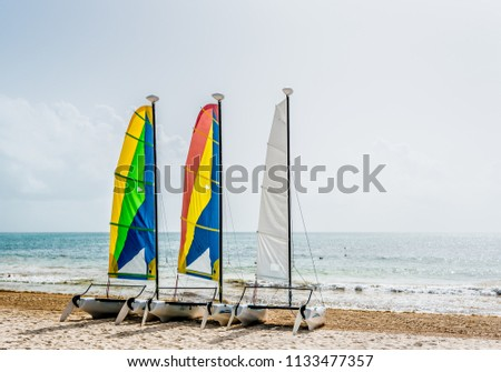 three-small-colorful-sailboats-sitting-4