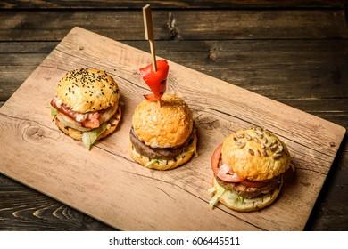 Three small hamburgers