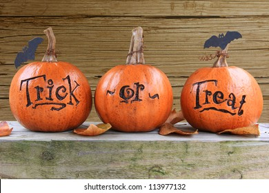 Three small trick or treat pumpkins.