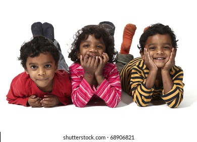three small twins lying on a white background