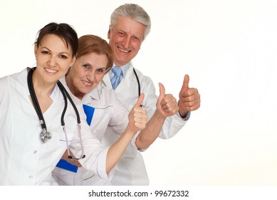 Three smiling Caucasian doctor standing on a white background