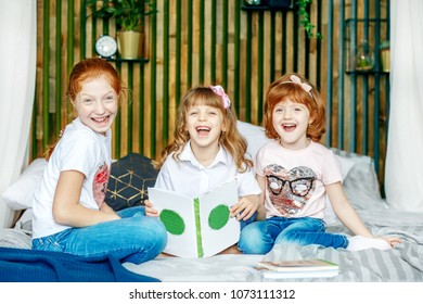 Three smiling children learn. Preparation for exams. The concept of lifestyle, childhood, education, family, school