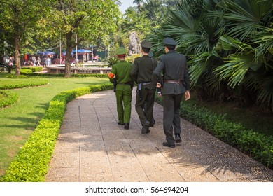 Three soldiers marching through the park in Hanoi, Vietnam, wearing uniform