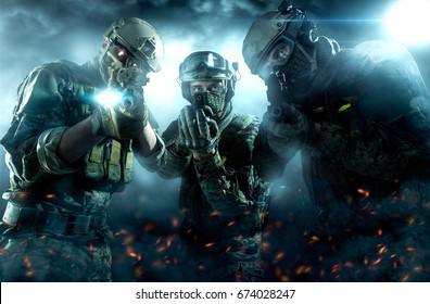 Three soldiers with weapons. Uniform conforms to Tactical Units of Police. Shot in studio. Light and smoke on a black background