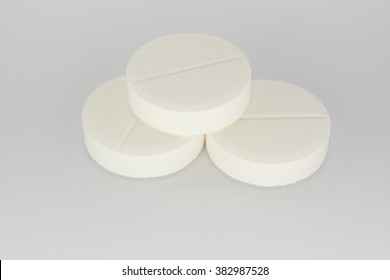 Three Soluble Tablets On White Background Stock Photo (Edit