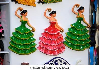 Three souvenir flamenco dancer fridge magnets, Malaga, Spain'