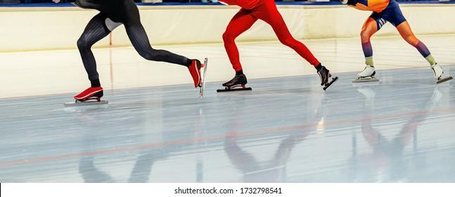 three speed skaters athletes in mass start speed skating