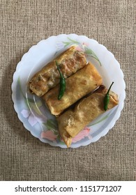 Three spring rolls top view, known as LUMPIA in Indonesia. Its famous hand made food from Semarang city, serve with hot green chilli or tomato sauce