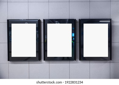 three square blank signs in the wall in subway station, to put your texts or logo