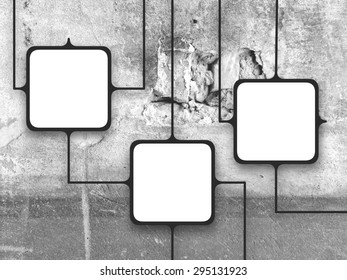 Three square frames on grey concrete wall background