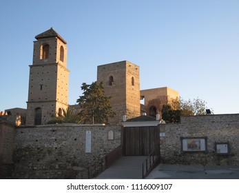Three square tower buildings at arabic castle in Andalusian village