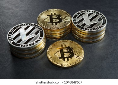 Three stack of cryptocurrency coins with single bitcoin