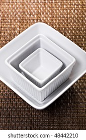Three Stacked Square Bowls on Place-mat