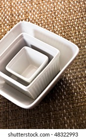 Three Stacked White Bowls On Placemat
