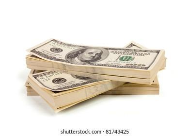 Three stacks of $100 bills isolated on white background