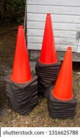 Three Stacks of Traffic Cones