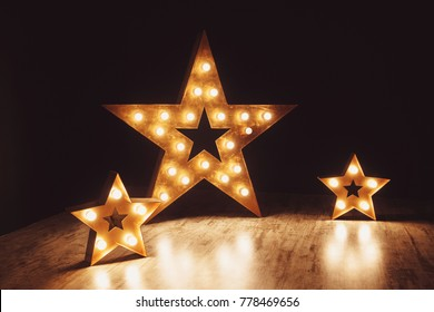 Three stars of light bulbs. Elements of decor in the form of stars.