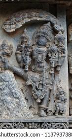 Three steps of Vishnu Trivikrama - Lakshmi Narasimha Temple, Nuggehalli, Hassan District of Karnataka state, India. The temple was built in 1246 CE rule of Hoysala Empire.