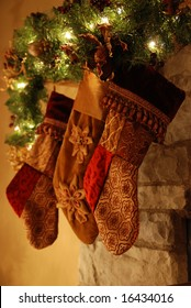 Three stockings hanging on the fireplace