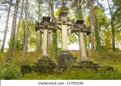 Three stone Celtic crosses in the woods
