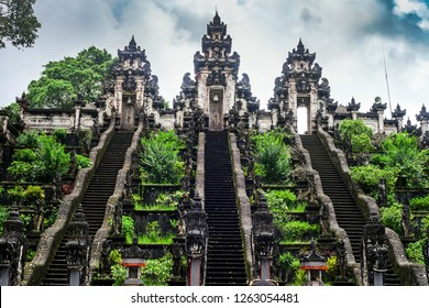 Three stone ladders in beautiful Pura Lempuyang Luhur temple. Summer landscape with stairs to temple. Paduraksa portals marking entrance to middle sanctum (jaba tengah) of Pura Penataran Agung, Bali
