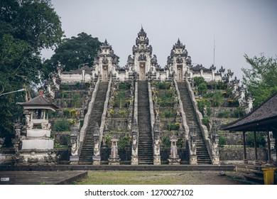 Three stone ladders in beautiful Pura Lempuyang Luhur temple. Summer landscape with stairs to temple. Paduraksa portals marking entrance to middle sanctum (jaba tengah) of Pura Penataran Agung, Bali