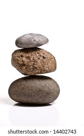Three stones balanced isolated on white background