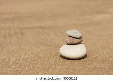 three stones on the sand