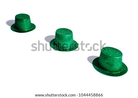 Three St.Patrick s Day hats in a diagonal row on white studio background 193907a2b40f