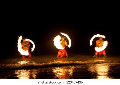 Three Strong Men Juggling Fire in Hawaii - Fire Dancers
