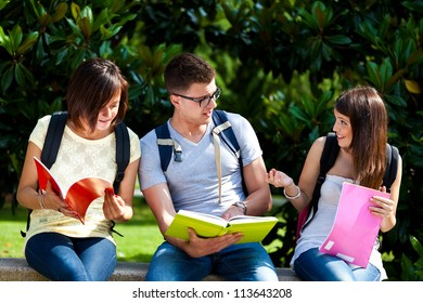Three students on a bench in the park
