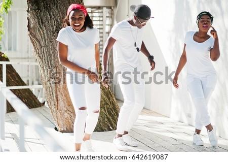 dd14b3094ad Three Stylish African American Friends Wear Stock Photo (Edit Now ...