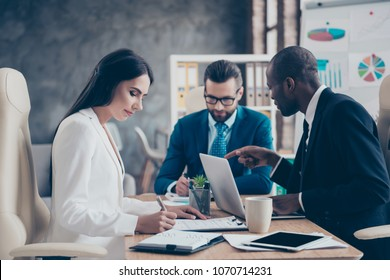 Three stylish, attractive, corporate, confident directors working in work place, station, wearing elegant, classic suits, developing new strategy, finding solution, solving problems