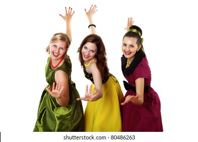 three stylish young woman in bright colour dresses