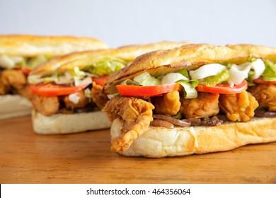 Three sub hoagie sandwiches closeup