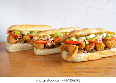 Three submarine hoagie sandwiches