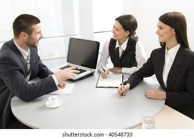 Three successful colleagues working  in the office