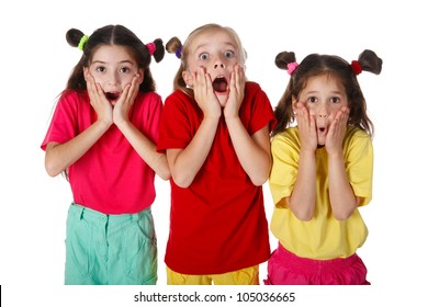 Three surprised little girls, isolated on white