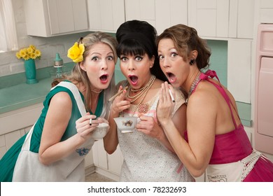 Three surprised middle-aged 1950s retro-style women with cigarettes and tea