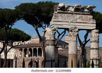 The three surviving corinthian columns of the Temple of Venus Genetrix (Tempio di Venere Genetrice) in the Imperial Forums in the centre of Rome in the late afternoon sun.