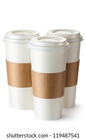 Three take-out coffee with cup holders. Isolated on a white.